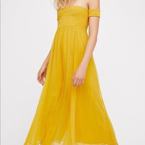 Free people strawberry swing jumpsuit in yellow